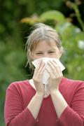 Woman with allergy, hay fever Stock Photos