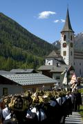 on the way to church feast of the grenadiers of the lord kippel loetschental  - stock photo