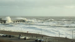 Brighton, UK. Stormy waves crash over  sea defenses. Stock Footage