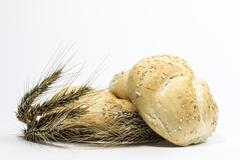 small bread and wheat ear - stock photo