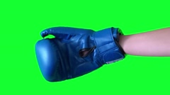 Green background, the hand in a Boxing glove Stock Footage
