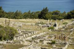 Ancient greece walls and pillars in ruins archaeological site kamiros island  Stock Photos