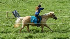 Mounted archery, female, slowmo - stock footage