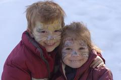 Two children with painted faces as cats for carneval Stock Photos