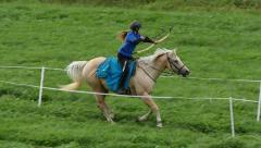 Mounted archery, woman, slowmo - stock footage