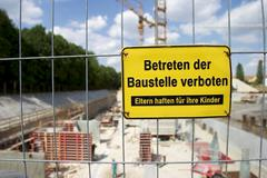 Fence of a building site with shield entering of building site prohibit on it Stock Photos
