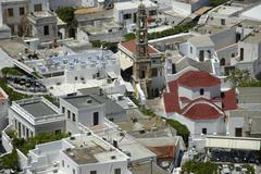 View on the roofs of lindos with agia panagia church island of rhodes greece Stock Photos