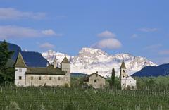 grange in village eppan in front of dolomites italy - stock photo