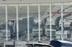 Lorries trucks reflectin in glass facade at the ferry port dover kent england Kuvituskuvat