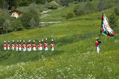 corpus christi procession grenadiers of the lord on the march wiler valais sw - stock photo