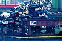 a piled up heap of old trash cars in the eastern harbor of frankfurt am maint - stock photo