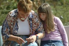 Mother and child cutting finger nails Stock Photos