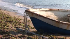 Boat at sea shore, in the morning in a fishermans village Stock Footage