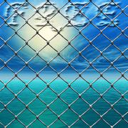 Freedom - link fence over sunny sky and sea Stock Illustration