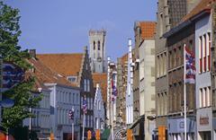 Stock Photo of narrow lane and tower belfried in brugge belgium