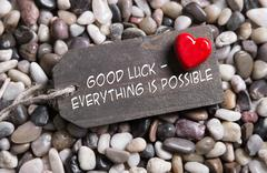 good luck and everything is possible: greeting card with red heart for courag - stock photo