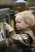 little boy, 1 - 2 years, with a tool - stock photo