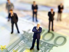 Businessmen and money Stock Photos