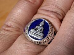 ring with buddha - stock photo