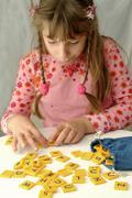 Girl learning the alphabet Stock Photos