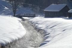 A stream in winter fumes from the rays of the sun styria Stock Photos
