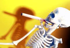 Smokind skeleton Stock Photos
