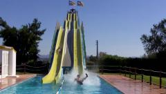 Fast Slides in Water Fun Park Playground Stock Footage