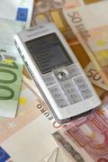 Handy and euro benk notes Stock Photos