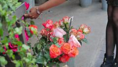 Woman Shopping for Flowers from a Market Stall Stock Footage