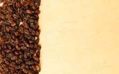 Border frame of raisin on wooden table background Stock Photos
