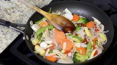 Fresh vegetables simmering in pan - stock footage