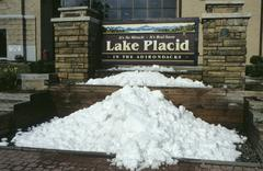 Stock Photo of snow in summer in front of lake placid townhall, usa