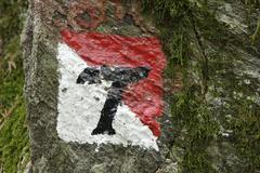 Way mark of the hiking trail with religious sculptures called reflection of the Stock Photos