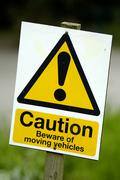 Warning sign caution beware of moving vehicles Kuvituskuvat