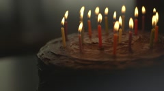 Birthday cake and candles blown out - stock footage