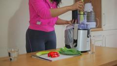 Woman Making a Healthy Vegtable Juice Stock Footage