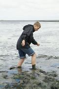 boy in the watt on the north sea island nordstrand - stock photo