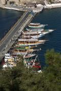 Turkey kusadasi southern agean coast dike with tourist boats to the pigeon is Stock Photos