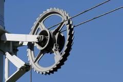 clamping line with guidance wheel for the overhead line of the streetcar - stock photo