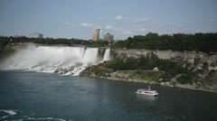 Tourist Cruise Ship at Niagara Falls on the USA-Canadian border Stock Footage