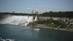 Tourist Cruise Ship under Niagara Falls on the USA-Canadian border Stock Footage