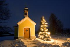 chapel with christmastree at dusk upper bavaria, germany - stock photo