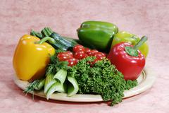 vegetable plate with capsicum, tomatos, zucchini, parsley, chive dill and cel - stock photo