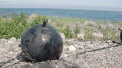 A big black sea mine on top of a hill near the sea, fs700 odyssey 7q Stock Footage