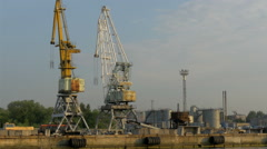 The huge cranes on standby on the harbour port in estonia, gh4 Stock Footage