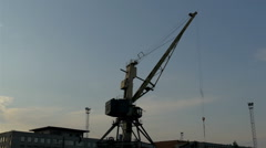 Big crane on standby on a dusky afternoon in the port, gh4 Stock Footage