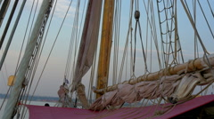 ropes and rolled big clothes on the sail mast of the ship, gh4 - stock footage
