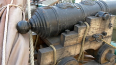 A small cannon handicraft on the boat on dock , gh4 Stock Footage