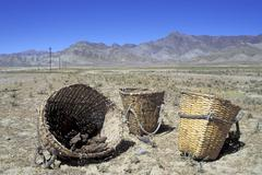 Baskets with dried dung Tibet Stock Photos