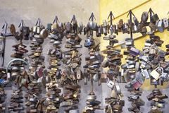Padlocks as signs of love on a fence in Pecs Hungary - stock photo
